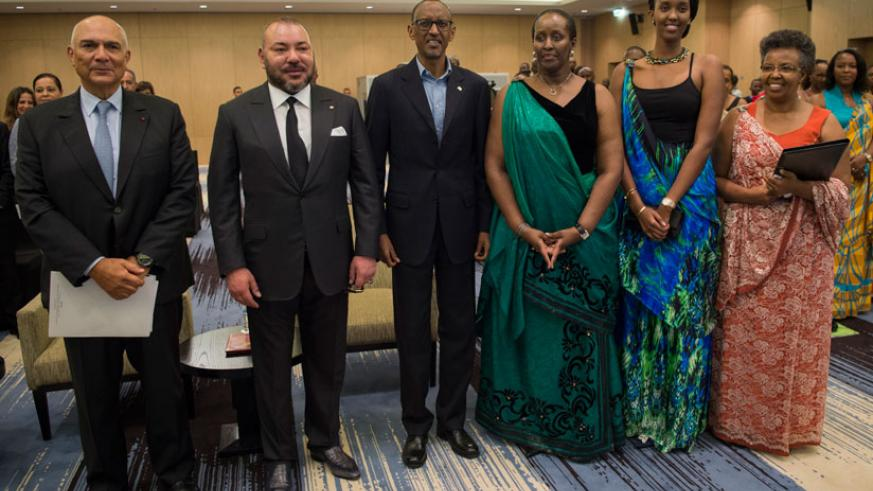 President Paul Kagame and visiting Moroccan King Mohammed VI pose for a group photo with the First Lady and Founding President of Imbuto Foundation Jeannette Kagame; first daughter....
