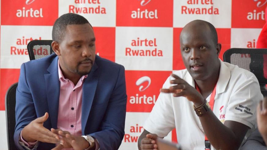 John Magara, the Airtel head of branding and marketing (right), speaks at the conference yesterday, while left is Abindabizemu, the marketing director. (Frederic Byumvuhore.)