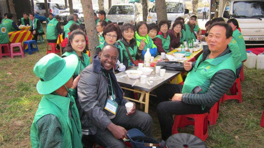 The New Times' Eugene Kwibuka poses for a photo with happy rural South Koreans.
