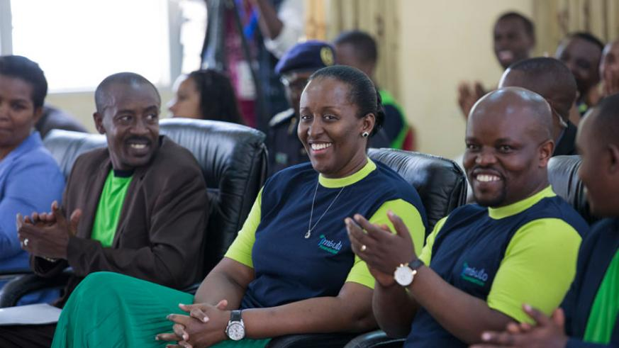 First Lady Mrs Jeannette Kagame, (C) Minister for Youth and ICT, Jean Philbert Nsengimana, (R) and mayor of Rwamagana Rajab Mbonyumuvunyi during the leadership and mentorship forum....