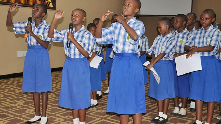 10-year old girls show their talent during an interactive session at the launch of the State of the World Population report in Kigali last week. / Elias Hakizimana.