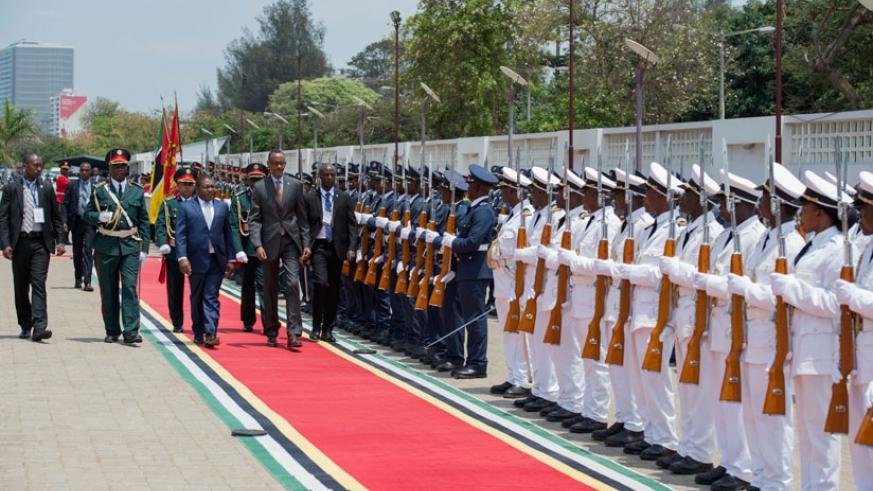 President Kagame and his host, President Filipe Nyusi of Mozambique, inspect a guard of honour in Maputo yesterday. The two Heads of State held bilateral talks prior to the signing....