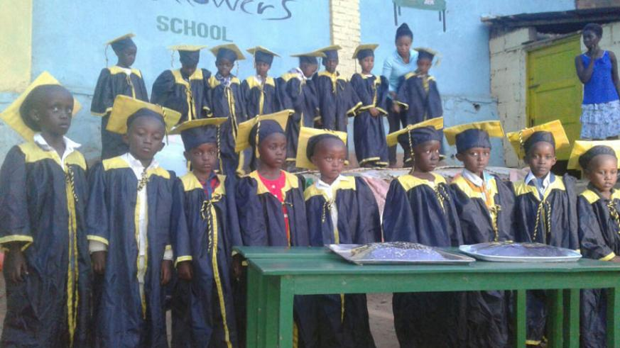 Pupils of Little Flowers donning gowns as they celebrate graduating from nursery. /  Hudson Kuteesa