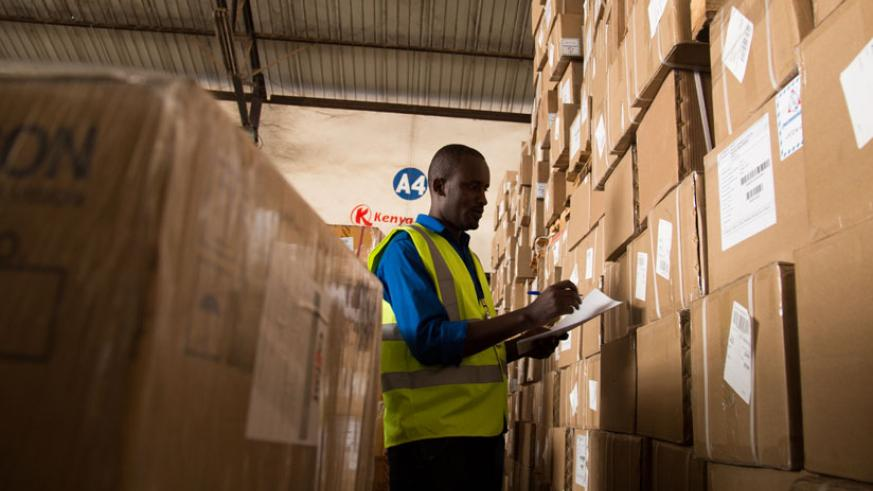 A worker at Magerwa bonded warehouse. The government is seeking to regulate warehouse services and value certificates for stored agricultural produce to boost commodities exchange.....