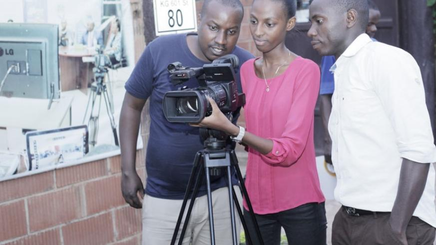 Trainers look on as a student demostrates her videography skills. (All photos by Dennis Agaba)