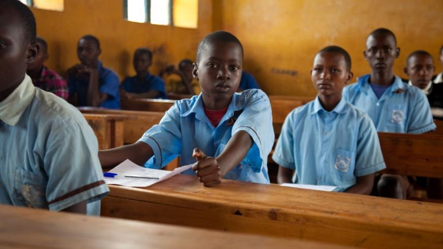 Pupils in Rwamagana await the start-time for examinations last year. Sixteen per cent more candidates will sit PLE this year. (File photo)
