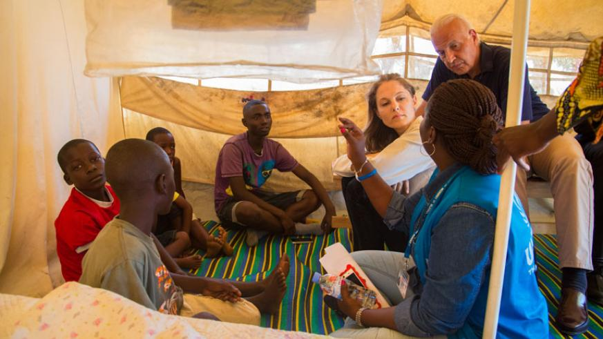 Inside a refugee shelter at the Mahama Refugee Camp, Princess Zeid listens to the story of some of the Burundian children who fled without their parents. / Faustin Niyigena