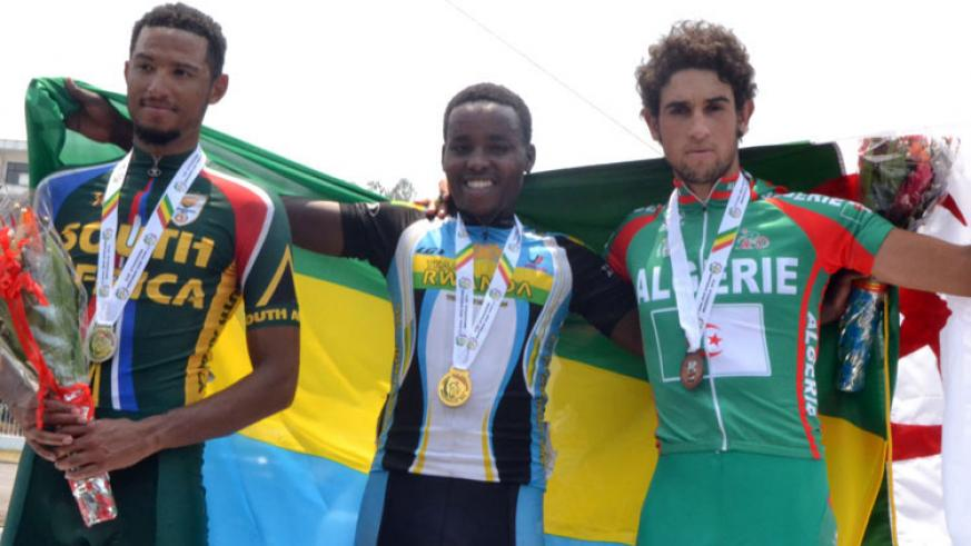 Retired cyclist, Janvier Hadi (C), secured Rwanda's first gold with a victory in the men's road race at the 2015 All Africa Games in Brazzaville. / File