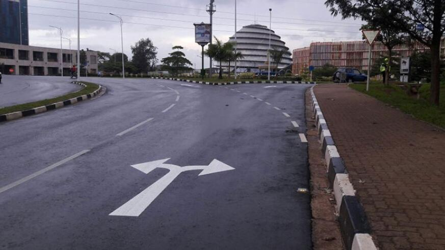 A picture of the KBC roundabout showing Kigali Heights (L) and Kigali Convention Centre and Radisson Blu Hotel. The City of Kigali has reopened access to motorists from the city ce....