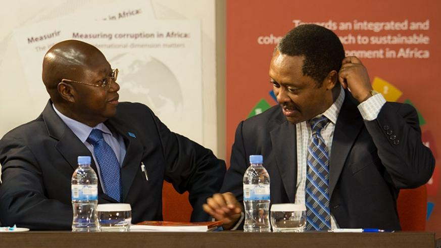 Manneh (L) chats with Prof. Shyaka during the launch of the report in Kigali last week. Timothy Kisambira.