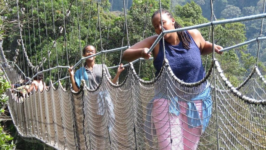 Some of the local tourists on the canopy walk. The walk is one of the most popular attractions among Rwandans. (Dennis Agaba.)