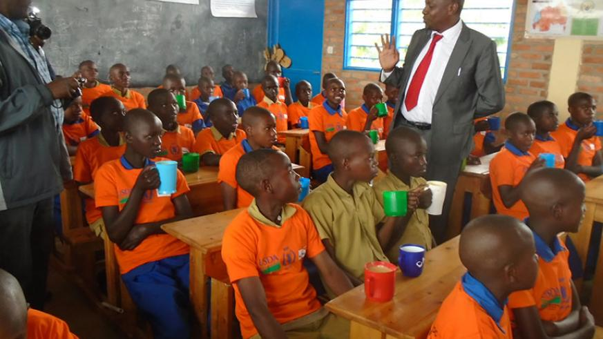 Pupils of P4 at Sanza Primary School during a visit by State Minister Munyakazi. / Lydia Atieno