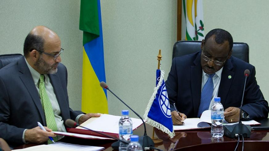 World Bank country manager Yasser El Gammal (L) and Finance and Economic Planning minister Claver Gatete sign the Rwf77 billion concessional loan agreement in Kigali yesterday. (Ti....