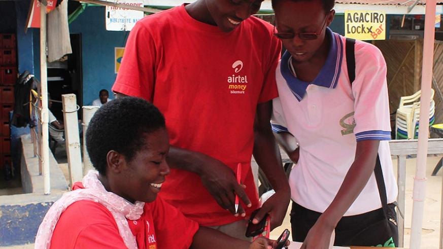 Airtel Money agents serve a clients. Entrepreneurs like these ones still face a lot of challenges. / File