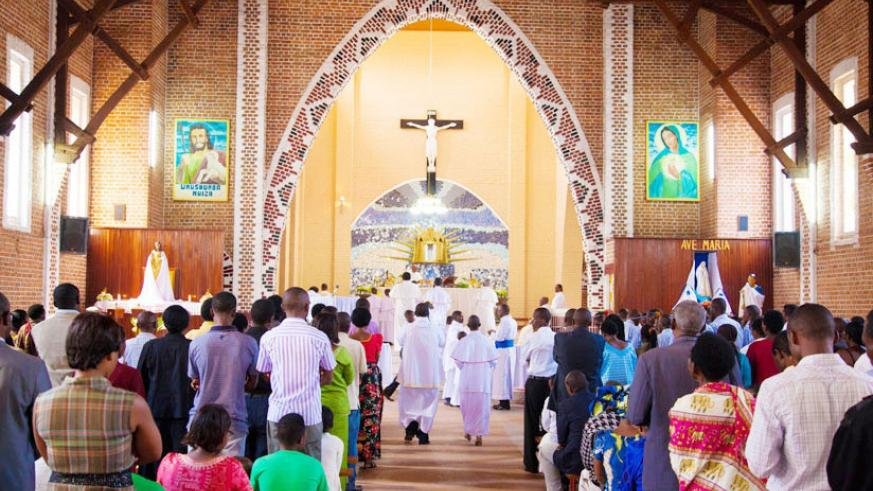 Christians attend a Mass at Ste Famille Church in Kigali. / File