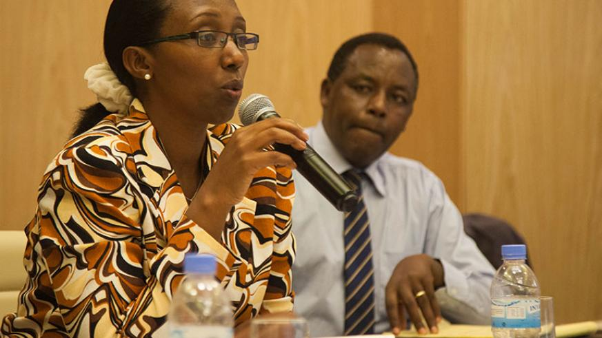 Eng. Coletha Ruhamya, director-general of Rwanda Environment Management Authority, speaks during the meeting between government stakeholders and the Rwanda Institute of Architects as Innocent Kabenga, country director of Global Green Growth Institute, looks on in Kigali yesterday. (Photos by Nadege Imbabazi)