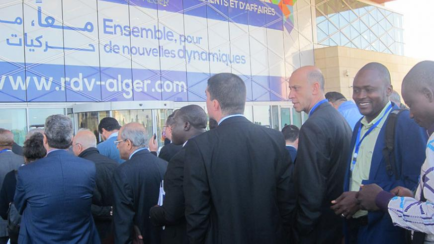 Delegates at the Africa business forum enter the meeting venue at the International Conference Center in Algiers on Saturday. / Eugene Kwibuka