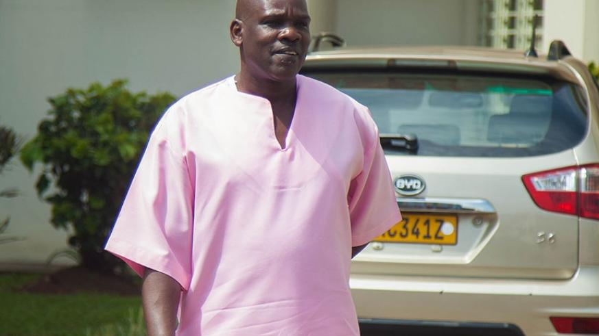 Genocide suspect Ntaganzwa leaves court after the hearing yesterday. (Nadege Imbabazi.)