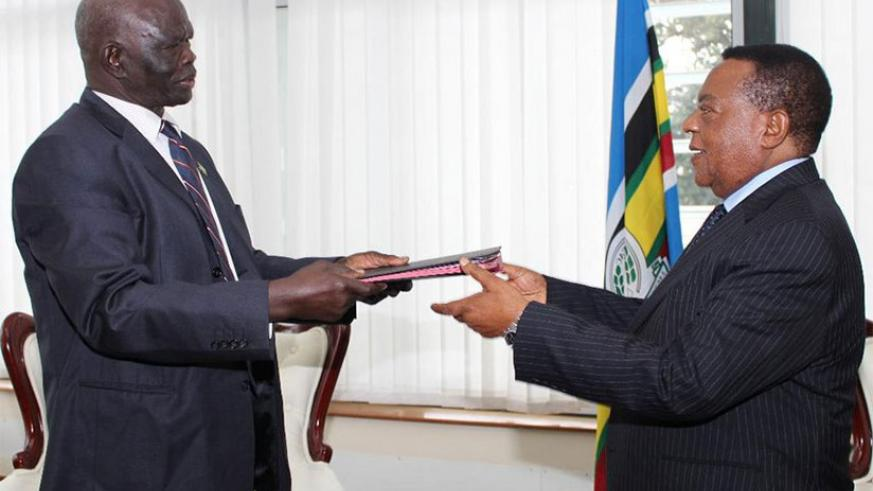 Chair of the EAC Council of Ministers Augustine Mahiga receives document of instrument of ratification from Aggrey Tisa SabunI of South Sudan in Arusha, last year. / Internet photo