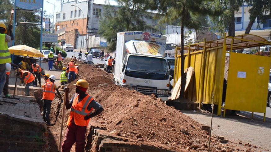 Workers remove electric cables in downtown Nyabugogo to pave way for the city roads upgrade that kicked off yesterday. Officials from HYCOGEC Consultant Ltd, the firm hired to supe....