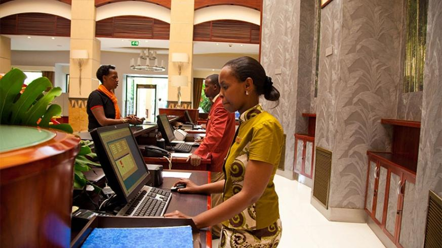 Frontdesk mangers at a Hotel reception in Kigali city. File
