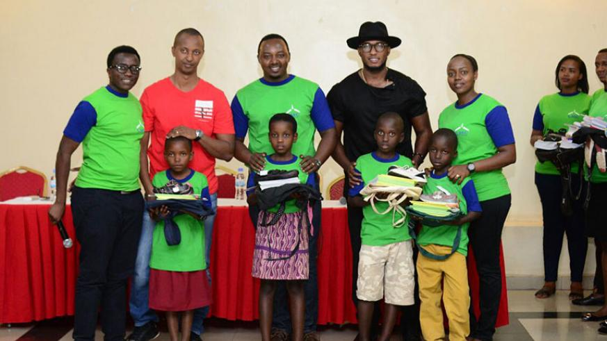 The Ben (in hat) and other members of Light my Candle organisation in a group photo with the children who were supported. / Francis Byaruhanga