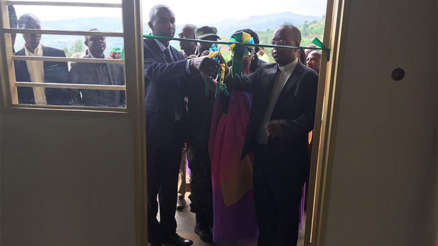 Ruhango mayor Mbabazi and other guests cut a ribbon at the launch of the nursery school. / Courtesy