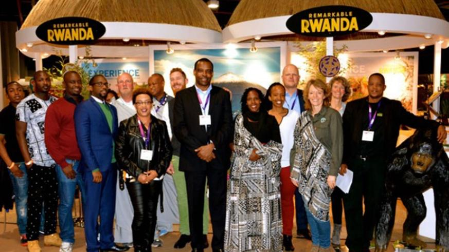 Officials and some exhibitors at the Rwandan stall in a group photo. Courtesy.
