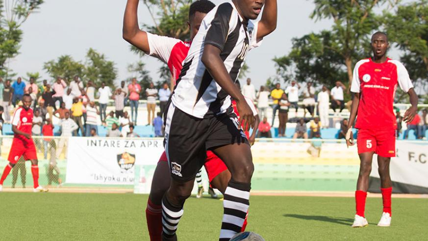 APR forward Muhadjir Hakizimana takes on Kirehe defender during the recent league match. / Timothy Kisambira