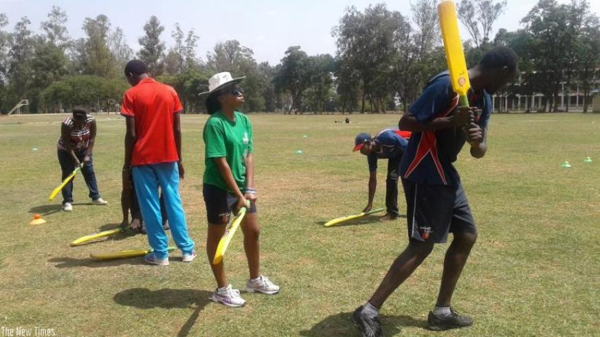 The local coaches during a practical session at Kicukiro cricket ground. P. Kabeera