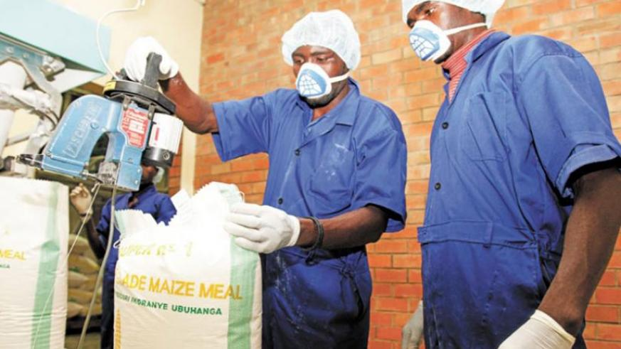 Workers at minimex, a local maize milling factory. File