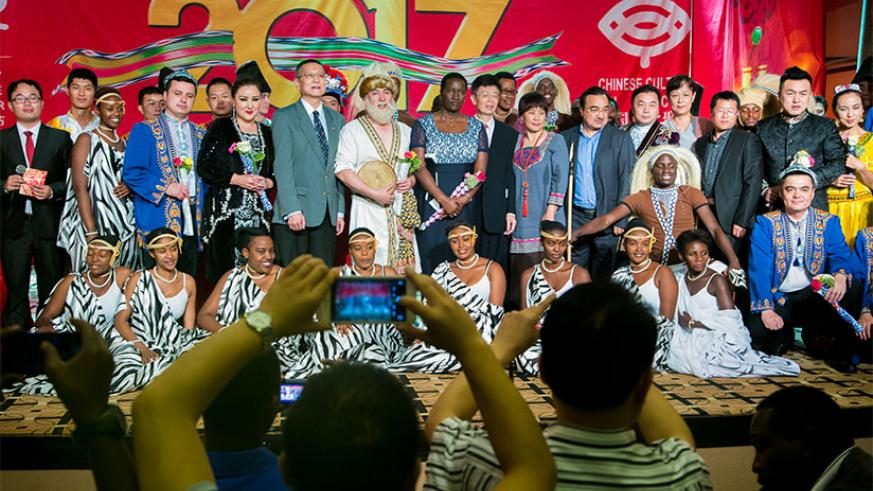 Minister Julienne Uwacu (C) and the Chinese Embassy officials in a group photo with the Urukerereza cultural dance troupe after the festival on Thursday at Serena Hotel in Kigali. ....