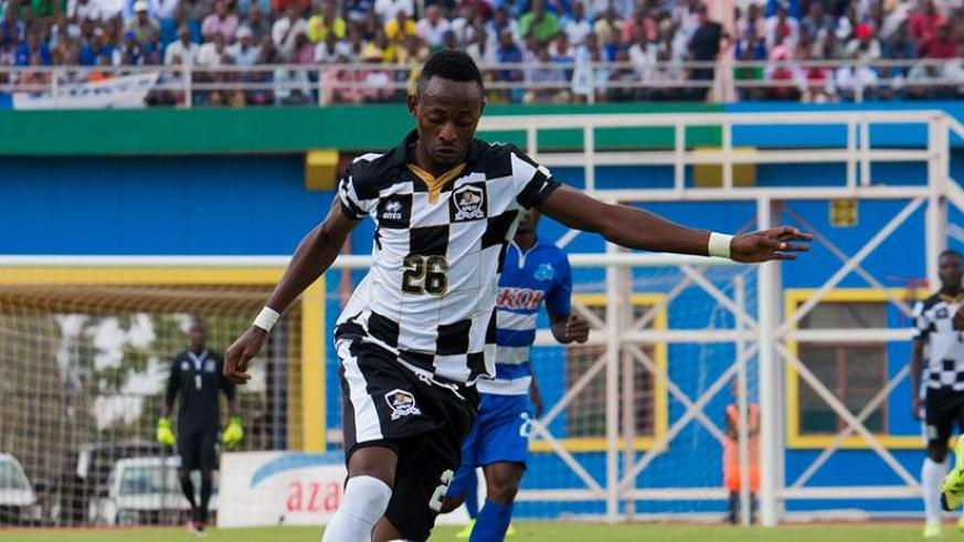 APR striker Issa Bigirimana takes a shot at goal during yesterday's league game against Rayon Sports. He scored the only goal for APR. / Timothy Kisambira.