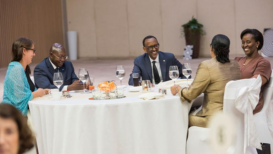 President Kagame and First Lady Jeannette Kagame chat with diplomats during the Diplomatic Luncheon hosted at the Kigali Convention Centre, yesterday. (Village Urugwiro)