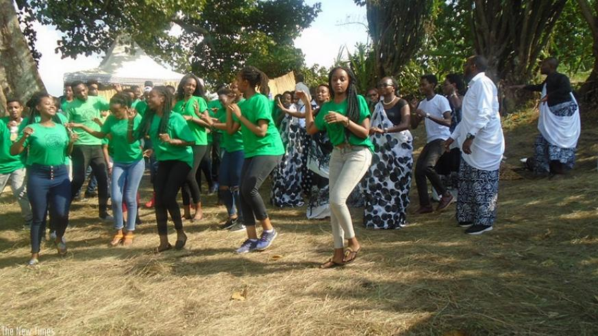 Students learn how to do the traditional Rwandan dance. / Lydia Atieno.
