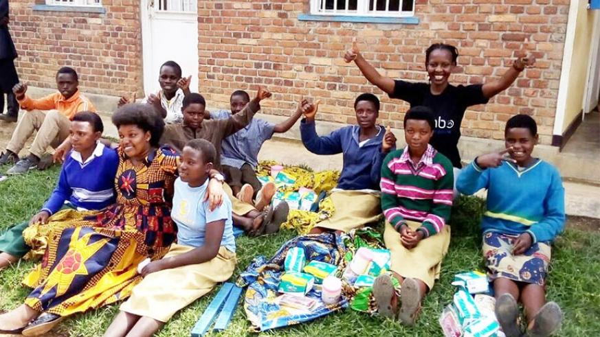 Umulisa (at the back) with some of the girls who recieved school requirements. (Photos by D. Mbabazi)