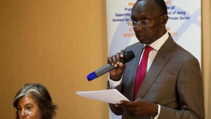 Chief Justice Sam Rugege (R) gives his remarks as Emily J. Gould, Esq Co-director, African Peace partners, looks on in Kigali. Timothy Kisambira.