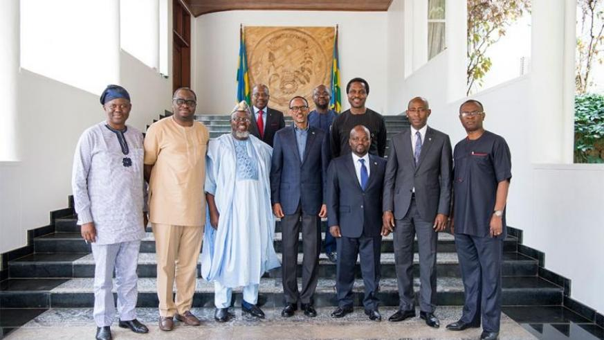 President Kagame in a group photo with a Nigerian delegation at Village Urugwiroyesterday. The delegation included Adebayo Abdul-Raheem Shittu, Nigerian minister of Communications;....