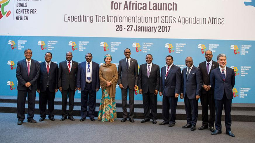 President Kagame in a group photo with other officials at the launch of the Sustainable Development Goals Centre For Africa in Kigali yesterday. The President called on African cou....