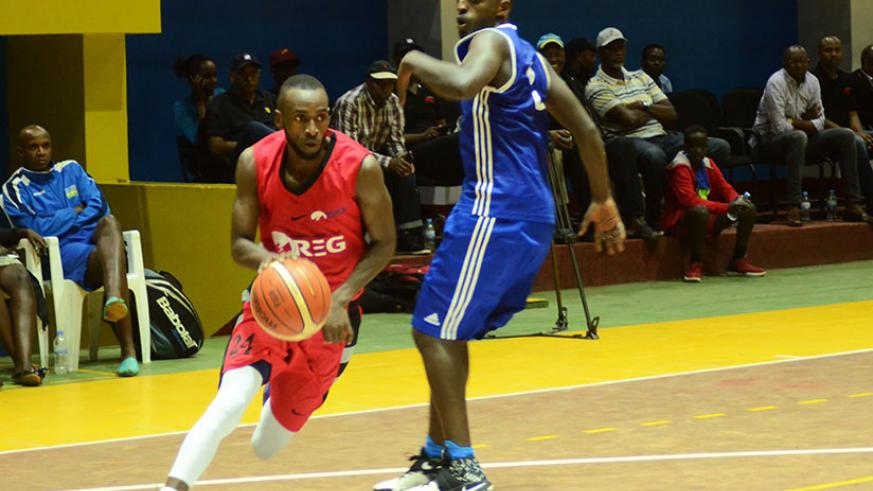 REG captain Kubwimana tries to go past Patriots' point guard Aristide Mugabe during the pre-season tournament at Amahoro indoor stadium. / Sam Ngendahimana