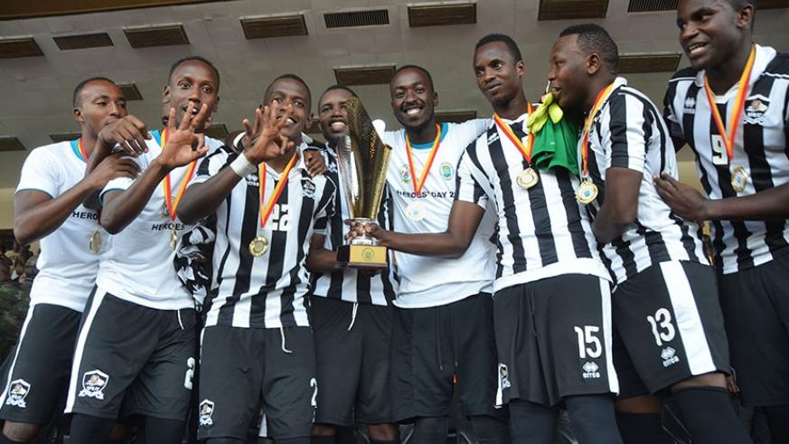 APR FC players hold the trophy to celebrate the crucial win against archirivals Rayon Sports 1-0 at Amahoro . (All photos by Sam Ngendahimana)
