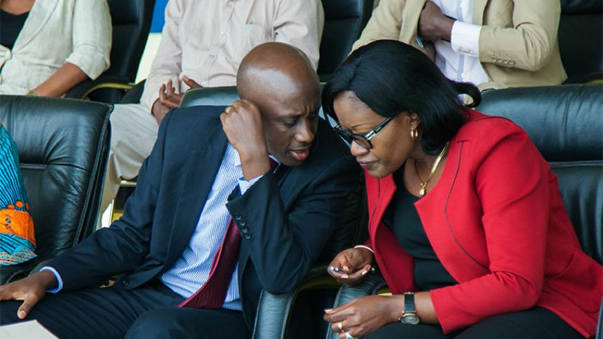 Local Government minister Francis Kaboneka chats with City of Kigali mayor Monique Mukaruliza during a meeting with Nyarugenge local leaders in Kigali yesterday. Kaboneka urged the....