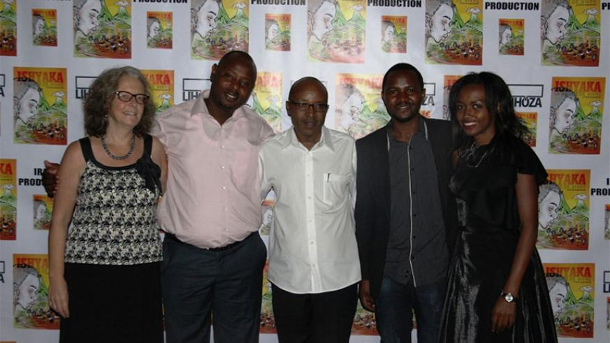 Bitamba poses with the crew behind Ishyaka's production during the premiere.