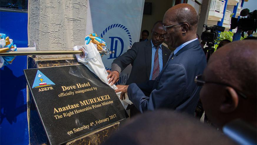 Prime Minister Anastase Murekezi inaugurates ADEPR Dove Hotel yesterday as church and local government officials look on. Murekezi said that hotel will go a long way in boosting Rw....