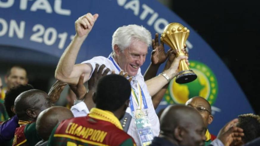 Cameroon coach Hugo Broos celebrates with the trophy.