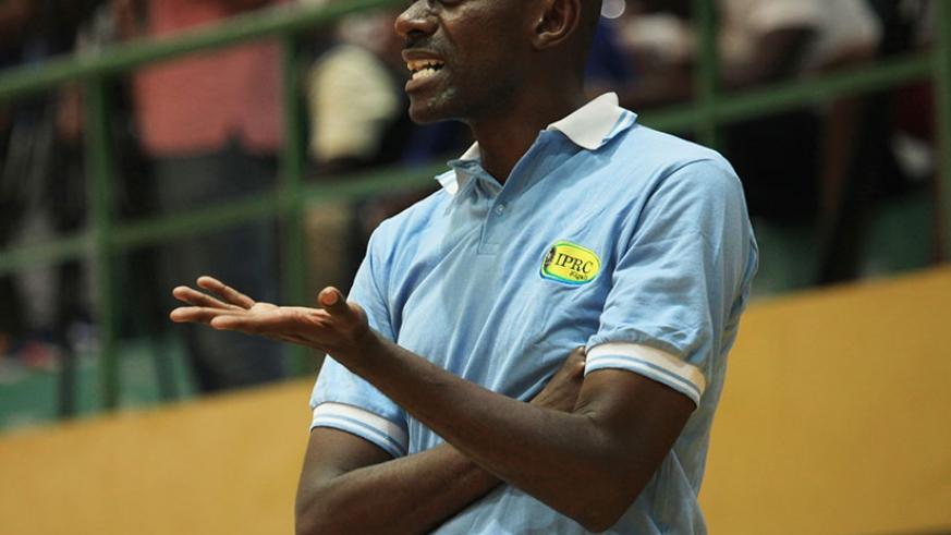 IPRC-Kigali head coach Albert Buhake gives instructions to his players during the Heroes' Day final match against Espoir on Sunday. Sam Ngendahimana.