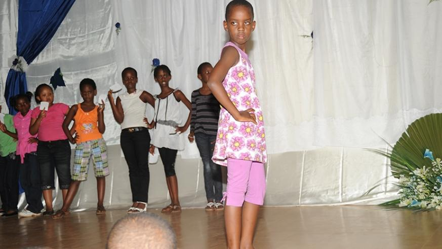 A child poses for a photo doing a fashion show in Kigali. File