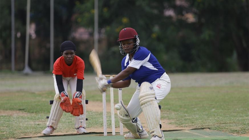 Oasis Cricket Club's Rachael Ntono contributed 18 runs in 21 balls against White Clouds  on Saturday at Kicukiro ground. (S. Ngendahimana)
