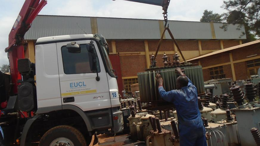 EUCL workers load transformers on a truck. (Photos by Michel Nkurunziza.)
