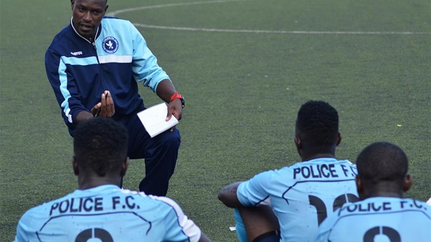 Police FC head coach Seninga gives instructions to his players at half time during a past match against Gicumbi FC. (Sam Ngendahimana)